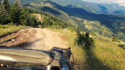 Tourists in an open jeep climbing mountain peak on a durty road Footage
