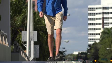 Man Walking on Sidewalk Footage