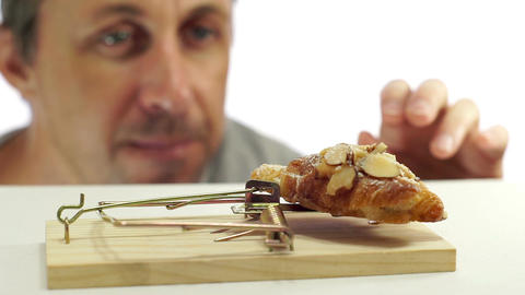 Man Looking at Bread In Mouse Trap Footage