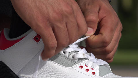 Male Athlete Tying His Shoes Footage