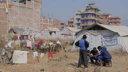 Men play game at refugee tent camp,Bhaktapur,Nepal Footage