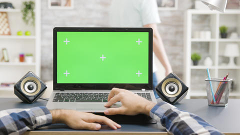 Man hands scrolling on laptop with green screen isolated mock up display Footage