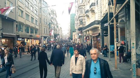 People walking on Istiklal Street , Beyoglu, Taksim. Daily life in istanbul. Tourism and city life Live Action