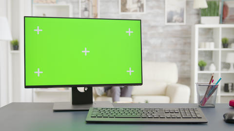 PC screen with isolated mock-up green screen display in bright living room Footage