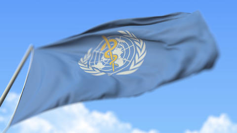 Waving flag of World Health Organization WHO, low angle view. Editorial loopable Live Action