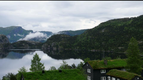 Reflexions and Clouds on Norway Lake in Arendal. TimeLapse 4k UHD Live Action