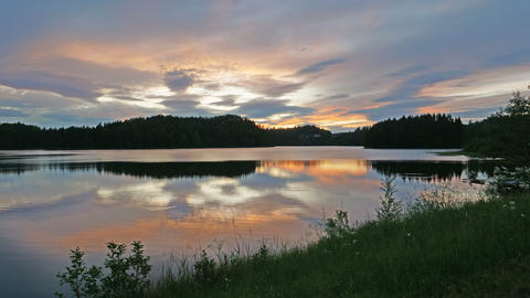Sunset on a Lake in Norway. Time Lapse UltraHD 2160p 4K Live Action