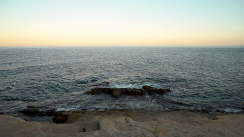 Waves on the Mediterranean Sea. The waves hit the rocks Live Action