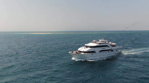 Big cruise ship is sailing in Dead Sea, sunny day and blue water, vacation Live Action