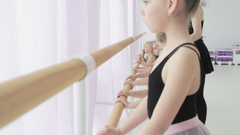Ballet School. Small ballerinas learn to dance. Beautiful view Live Action