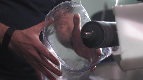 Production of a prosthetic leg. A man creates a part of… Stock Video Footage