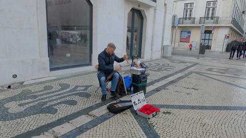 Street musician at famous Augusta street in Lisbon - CITY OF LISBON, PORTUGAL - Live Action