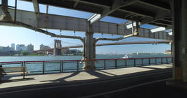Walkers and Joggers on the East River Bikeway with Brooklyn Bridge in Distance Footage