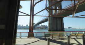 Profile View Riding on East River Bikeway with Brooklyn Bridge in Distance Footage