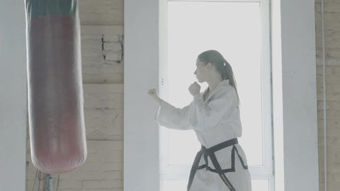 Taekwondo Girl Trains With Punching Bag In The Gym Footage