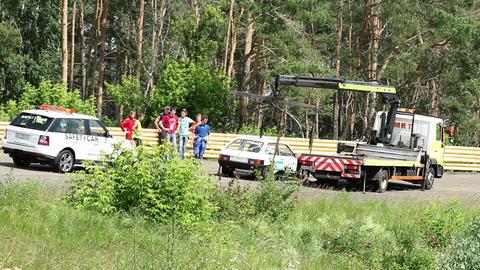 Broken racing car being evacuated from track timelapse Footage