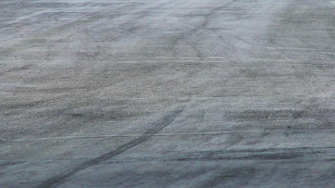 Hot tarmac on racing track as cars pass by Footage