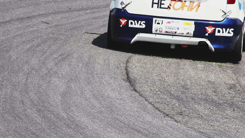 Rubber and traces of sport racing cars on track tarmac during race Footage