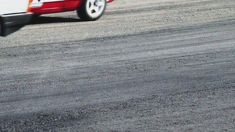 Sport cars pass by track tarmac at racing competition daytime Footage