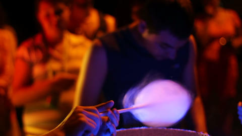 Cotton candy is prepared and bought at night, making process Footage