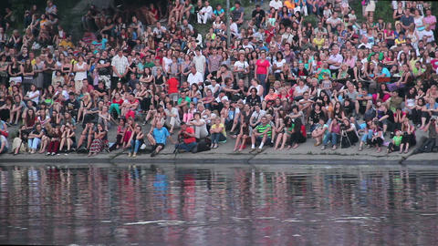 Crowd sitting watching show performance near water outdoors Footage