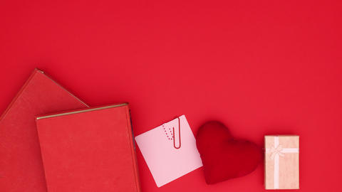 Beautiful red decoration with rose, books and present appear on red background - Valentine's day - Animation