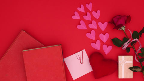 Pink paper hearts appear above beautiful Valentine's day decoration - Stop motion Animation