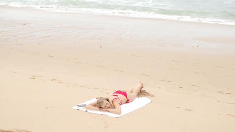A sandy beach at the ocean - perfect place for a summer vacation Live Action