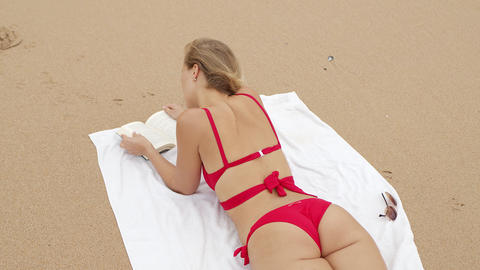 Sexy girl wearing a bikini at the beach - summer vacation at the ocean Live Action