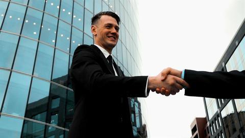 Business associates shaking hands Live Action