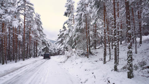 Off-road car, driving on mountain road in snowy road, surrounded by snow covered Live Action