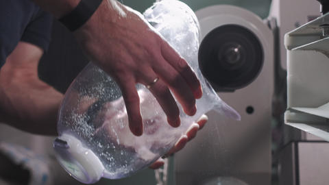 Production of a prosthetic leg. A man creates a part of... Stock Video Footage