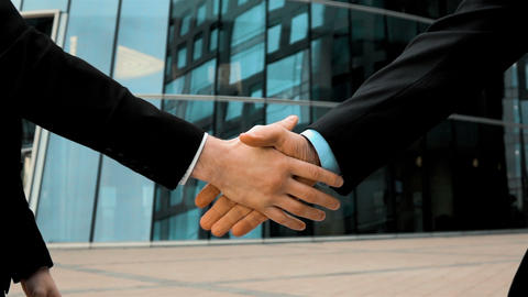 Two business partner shake hands Live Action