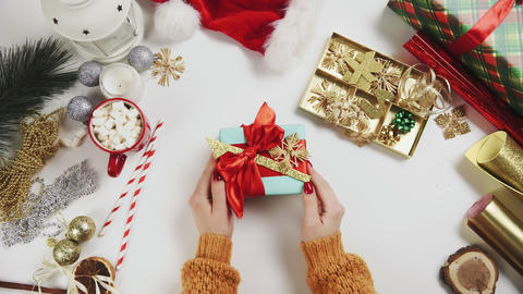 Top View Womans Hands with Christmas Present Live Action