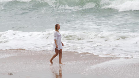 Walk over a sandy beach - sexy girl on holiday Live Action