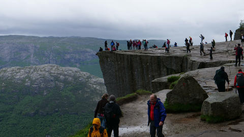 Tourist People Hiking to Prekestolen in Norway in Bad Weather Day. 4K Time Lapse Live Action