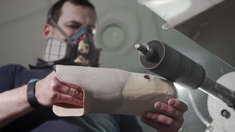 Production of a prosthetic leg. A man creates a part of the leg above the knee Live Action