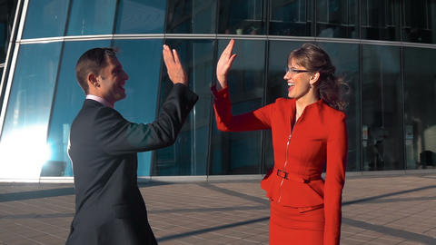 Business people high five outdoor Live Action