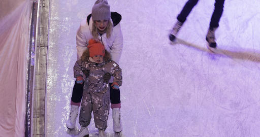 Teaching a child to skate on an ice rink Live Action