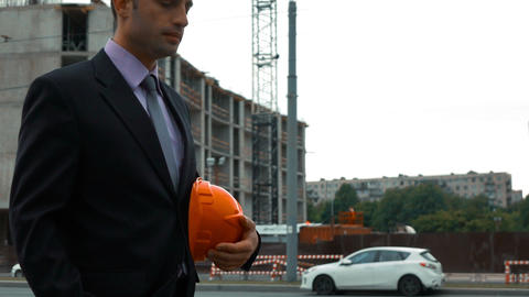 Attractive construction engineer answering call Live Action