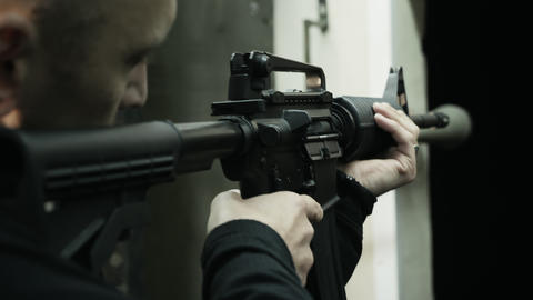 Military soldier with a carbine in his hands Live Action