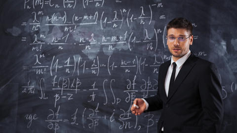 Young smart male teacher or student explaining decision of hard math equation Live Action
