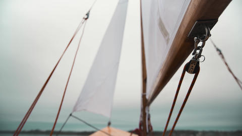 Sail on wooden sailboat with ropes and wooden blocks Live Action