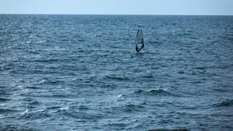 Single man have active relax with windsurfing. Black Sea Live Action