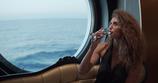 Luxury lifestyle - Woman drinking champagne. Elegant lady holding wine glass and Live Action