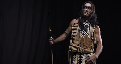 Indian native american with long black hair is lifting his head up, 4k Live Action