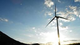 Wind turbine energy tower at sunset Footage