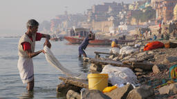 Men washing clothes in Ganges river,Varanasi,India Footage