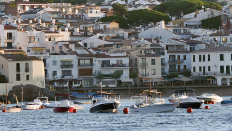 Anchored Boats in Front of a Mediterranean Village Footage