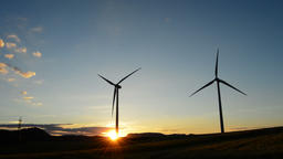 Wind turbines energy tower moving at sunset Footage